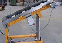Conveyor with supports that are electrically adjustable in height